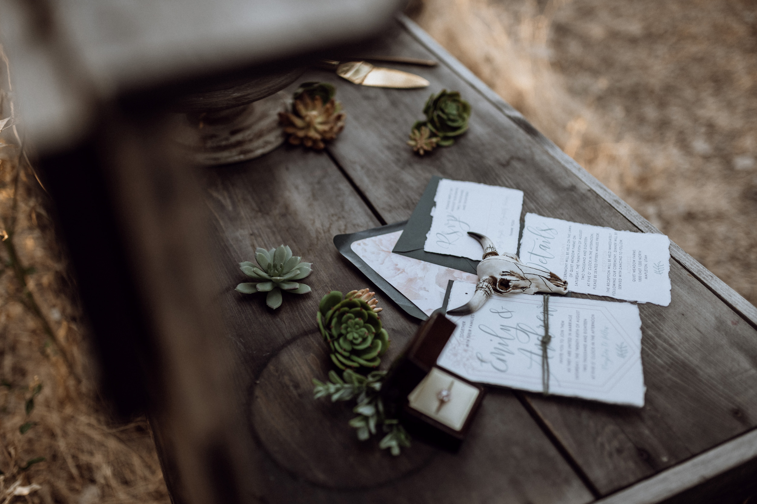 wedding stationary on wooden table