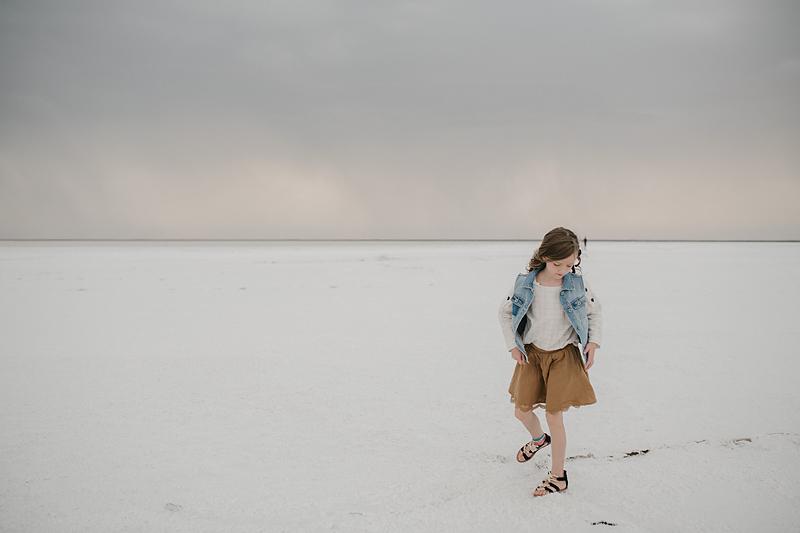 little girl in brown skirt on bonneville salt flats