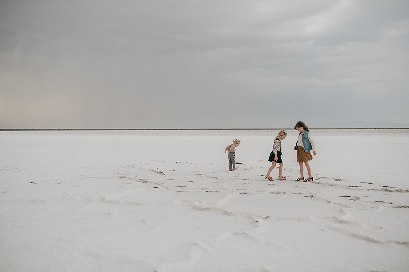 three sisters playing on the salt flats