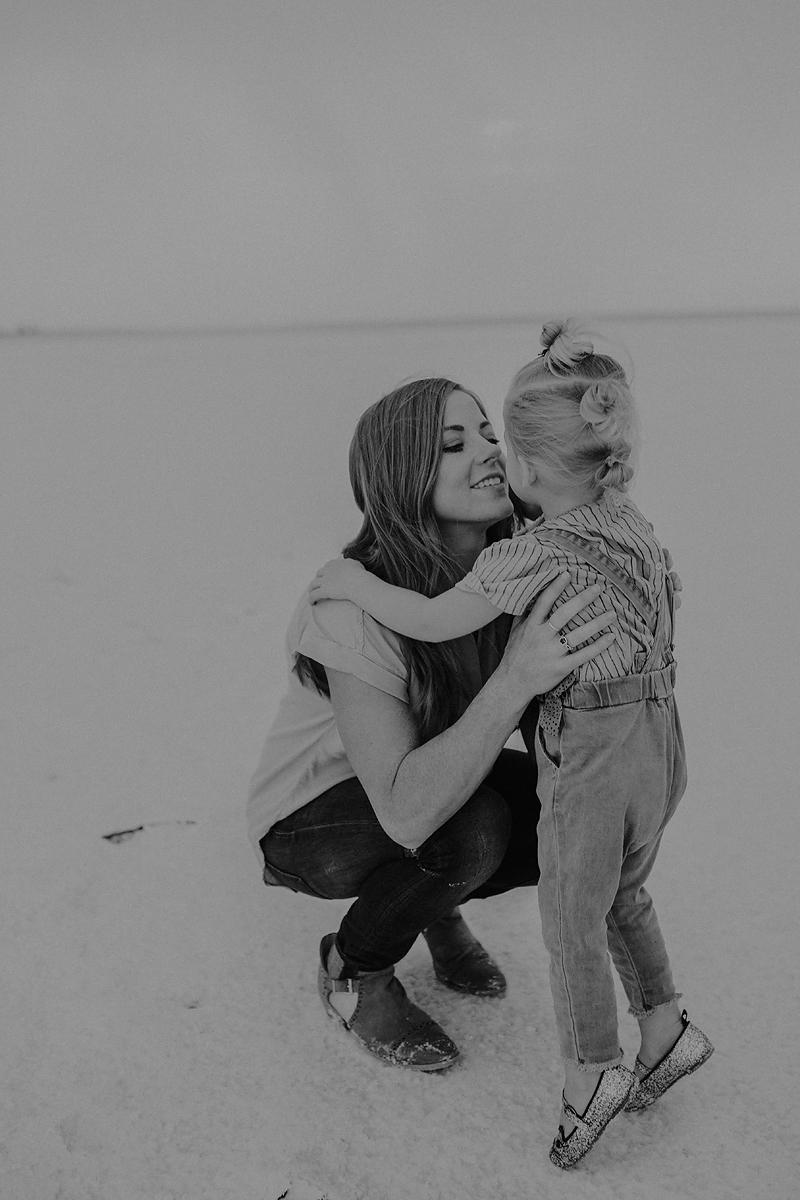 toddler girl hugging mom