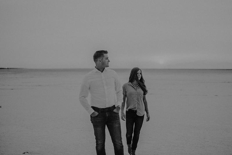 wife walking toward husband black and white