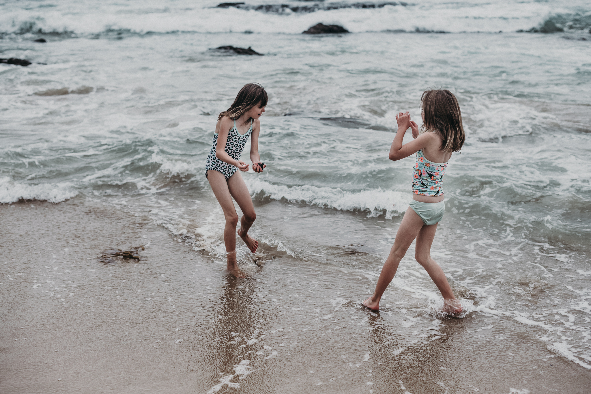 Young girls playing in shallow water