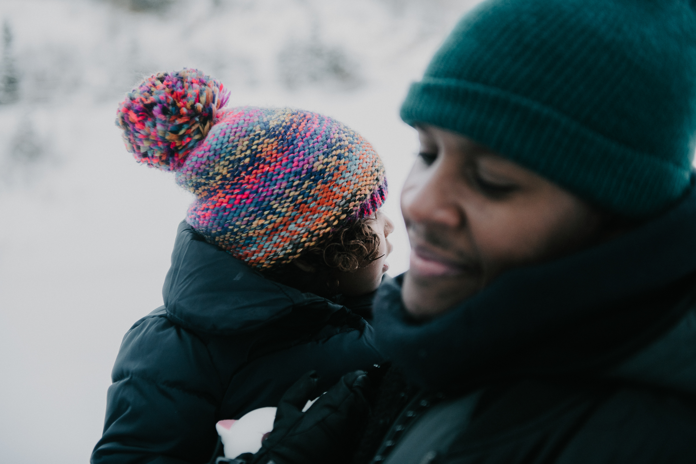 Dad and daughter in snowy mountain