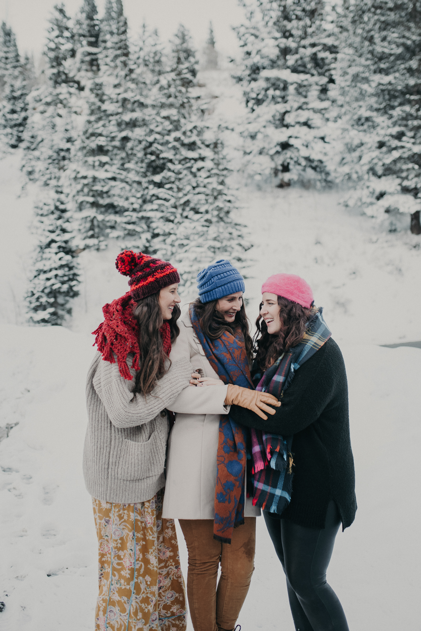 Sisters standing . together in snowy mountains