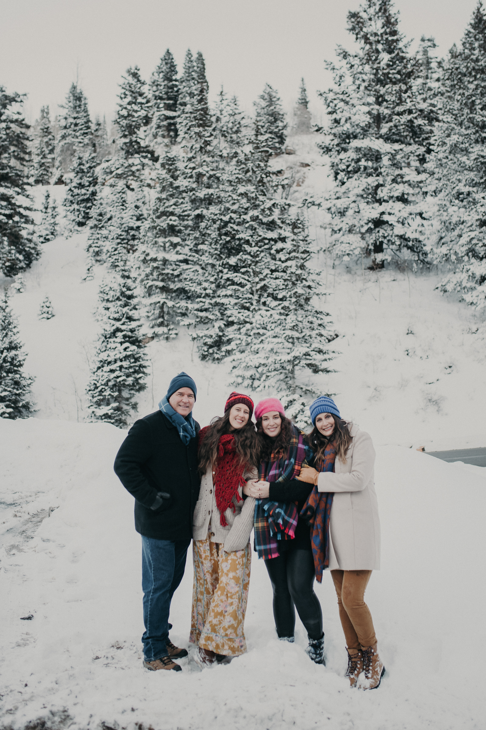 Extended family in snowy mountains