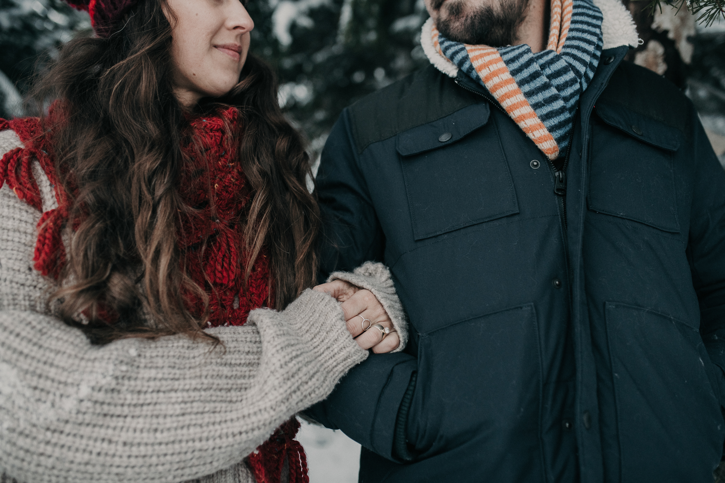 Couple standing together in snowy mountains