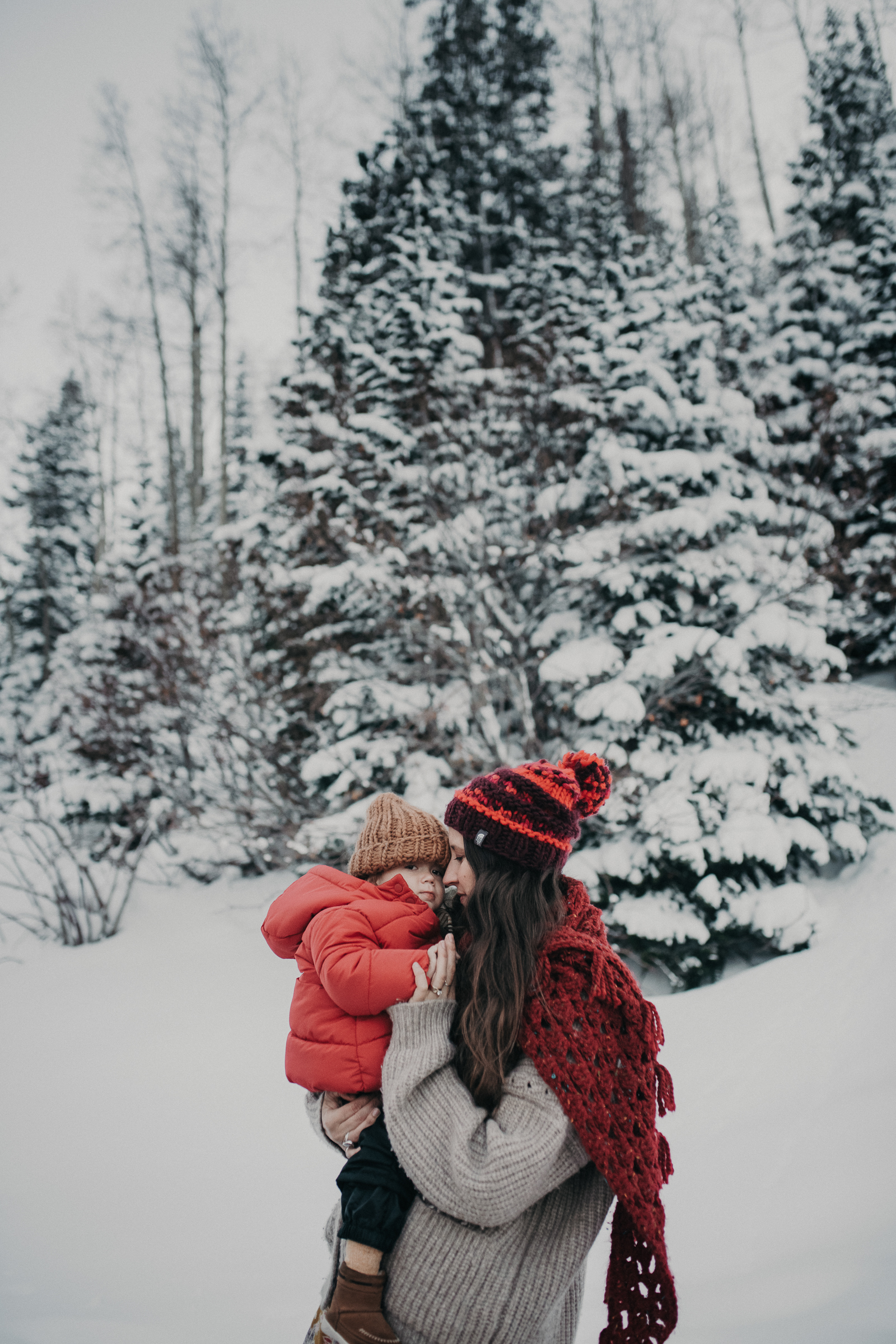 Mom and son in snowy mountains