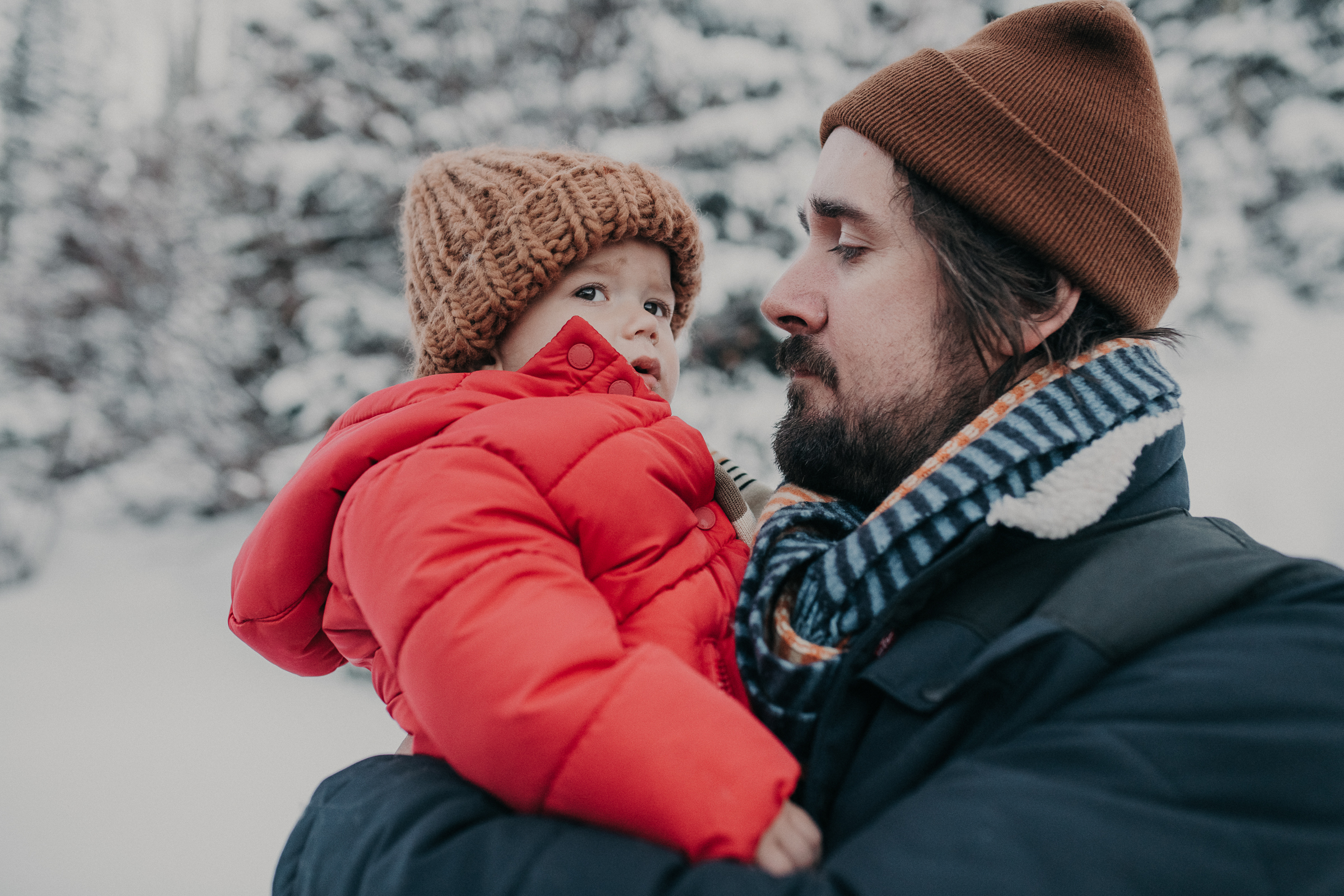 Dad and son standing in the snowy mountains