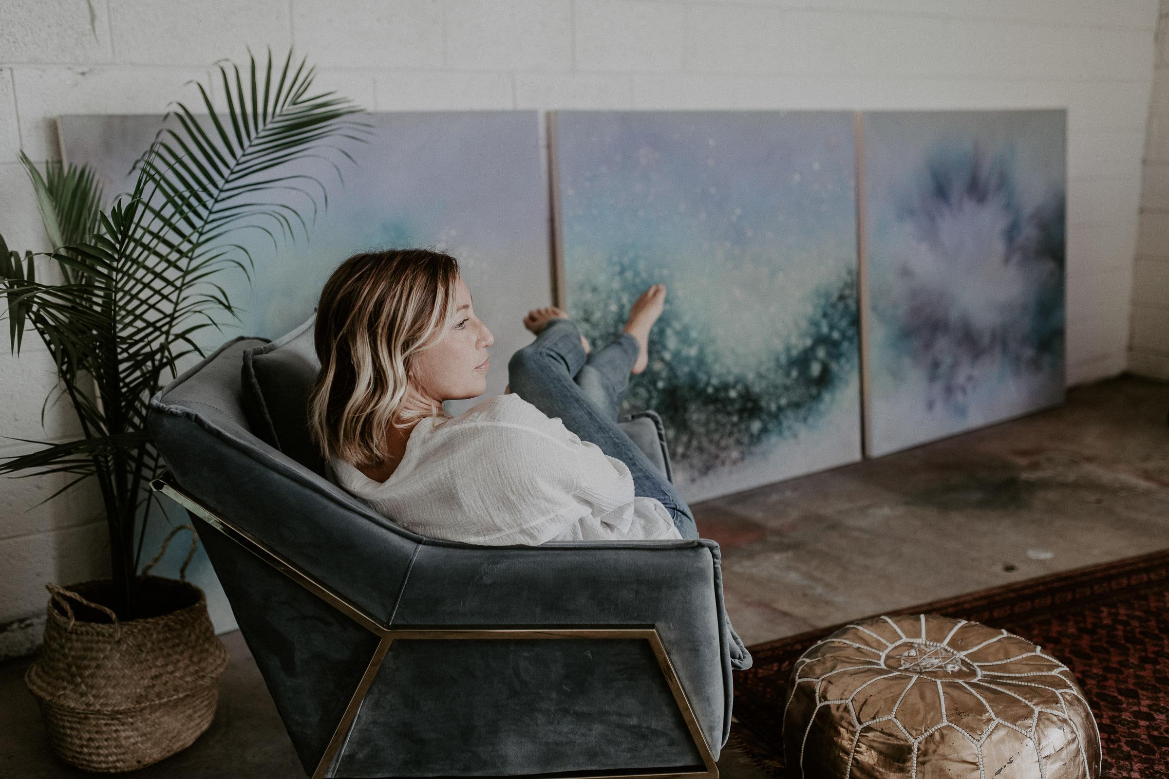 unique branding photography of artist in studio