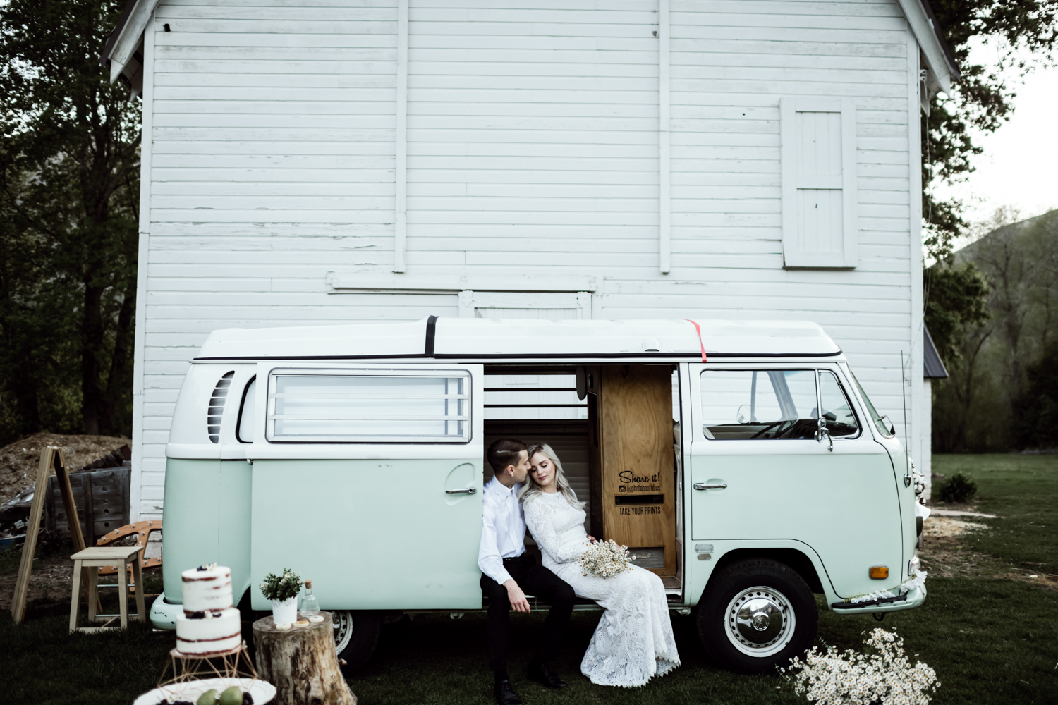 bride and groom sitting in vw bus