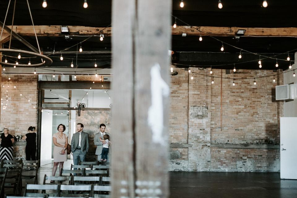 industrial wedding venue with guests