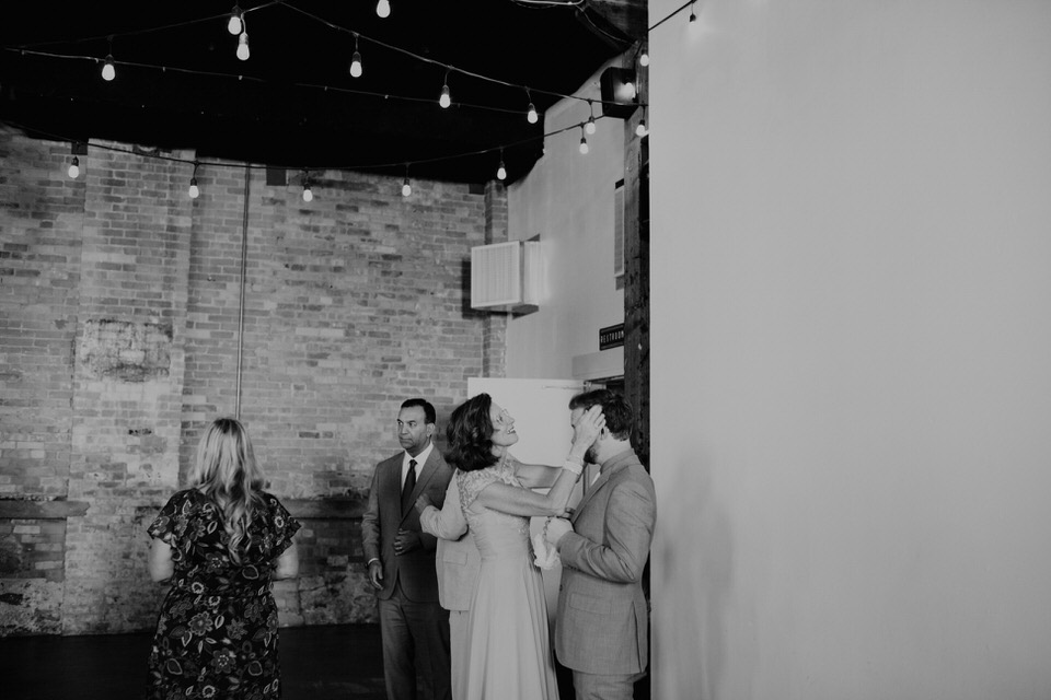 groom's mom fixing his hair at wedding