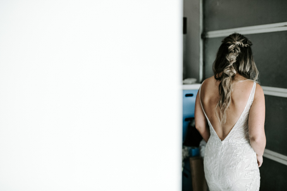back of bride in gown waiting to get married