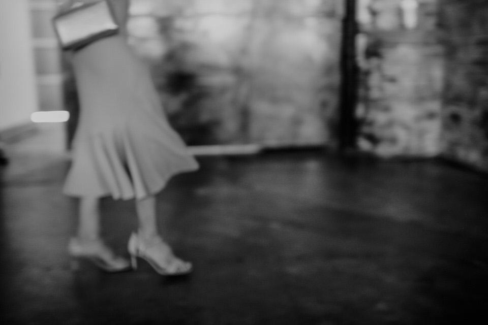 motion blur of lady walking at wedding