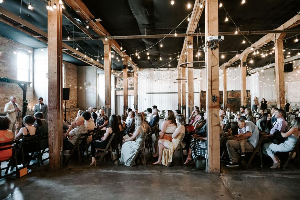 guests at wedding in industrial venue