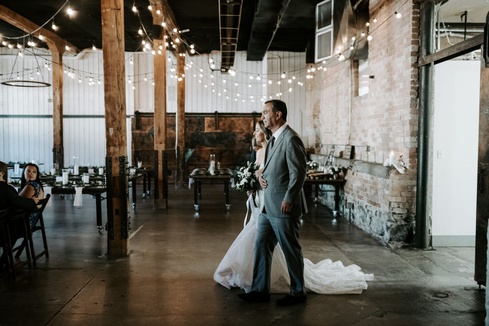 bride's dad walking her down the aisle at wedding