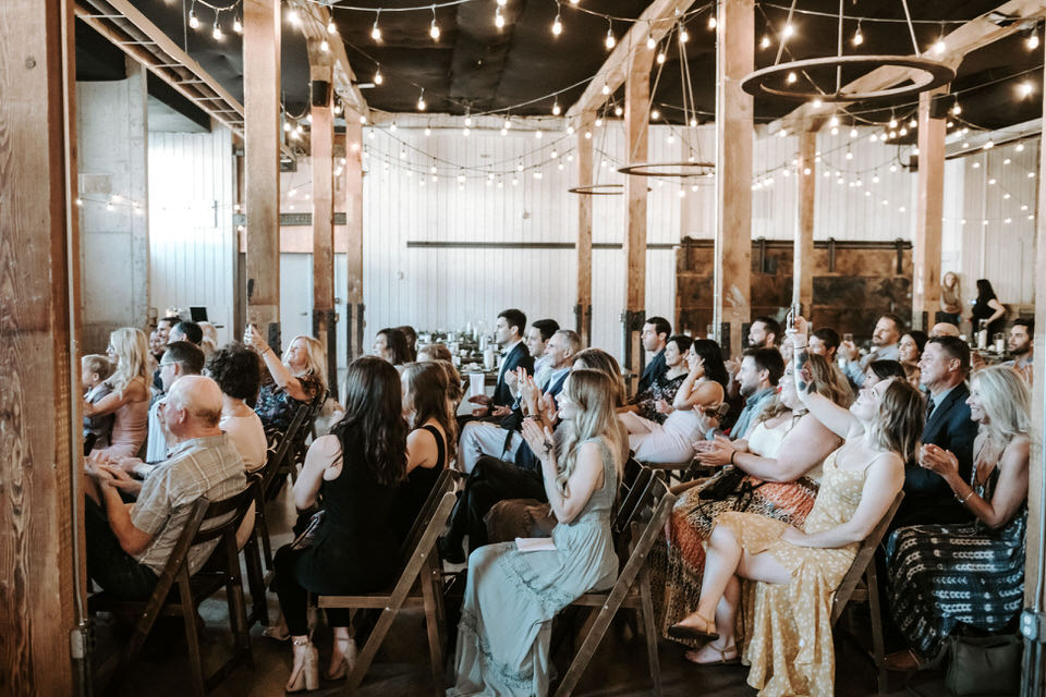 guests celebrating couple at wedding