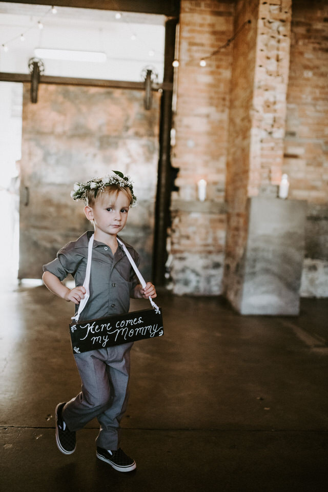 ring bearer wearing a floral crown at wedding