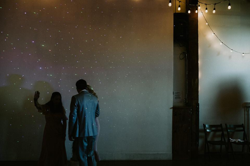 shadows of guests dancing at wedding reception