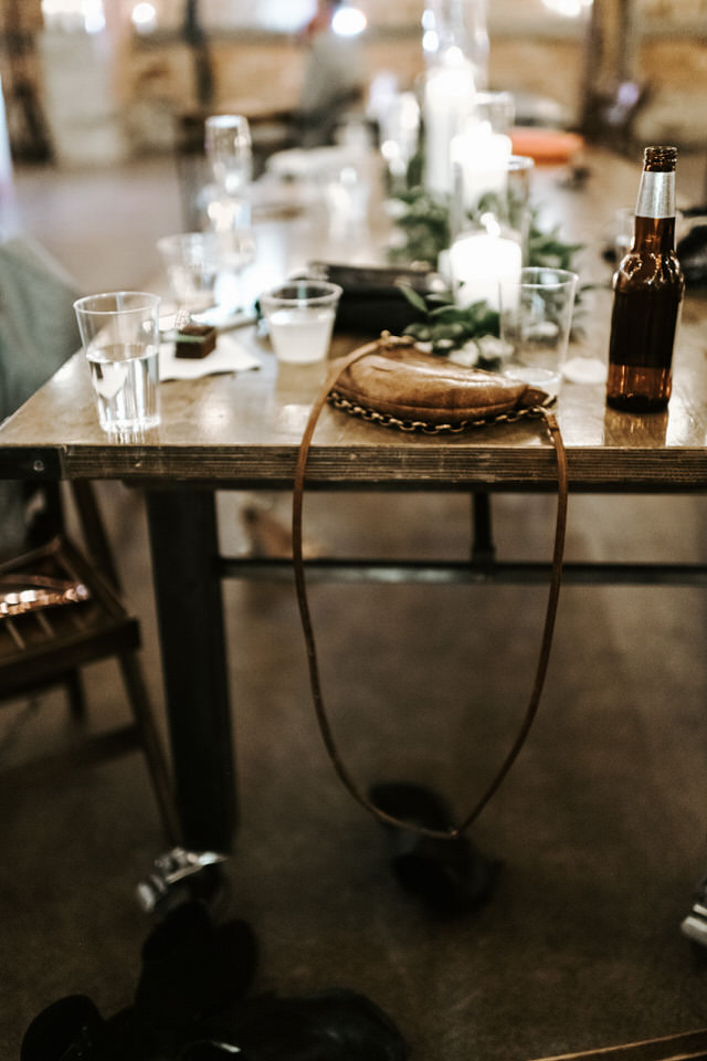 purse sitting on table at wedding reception