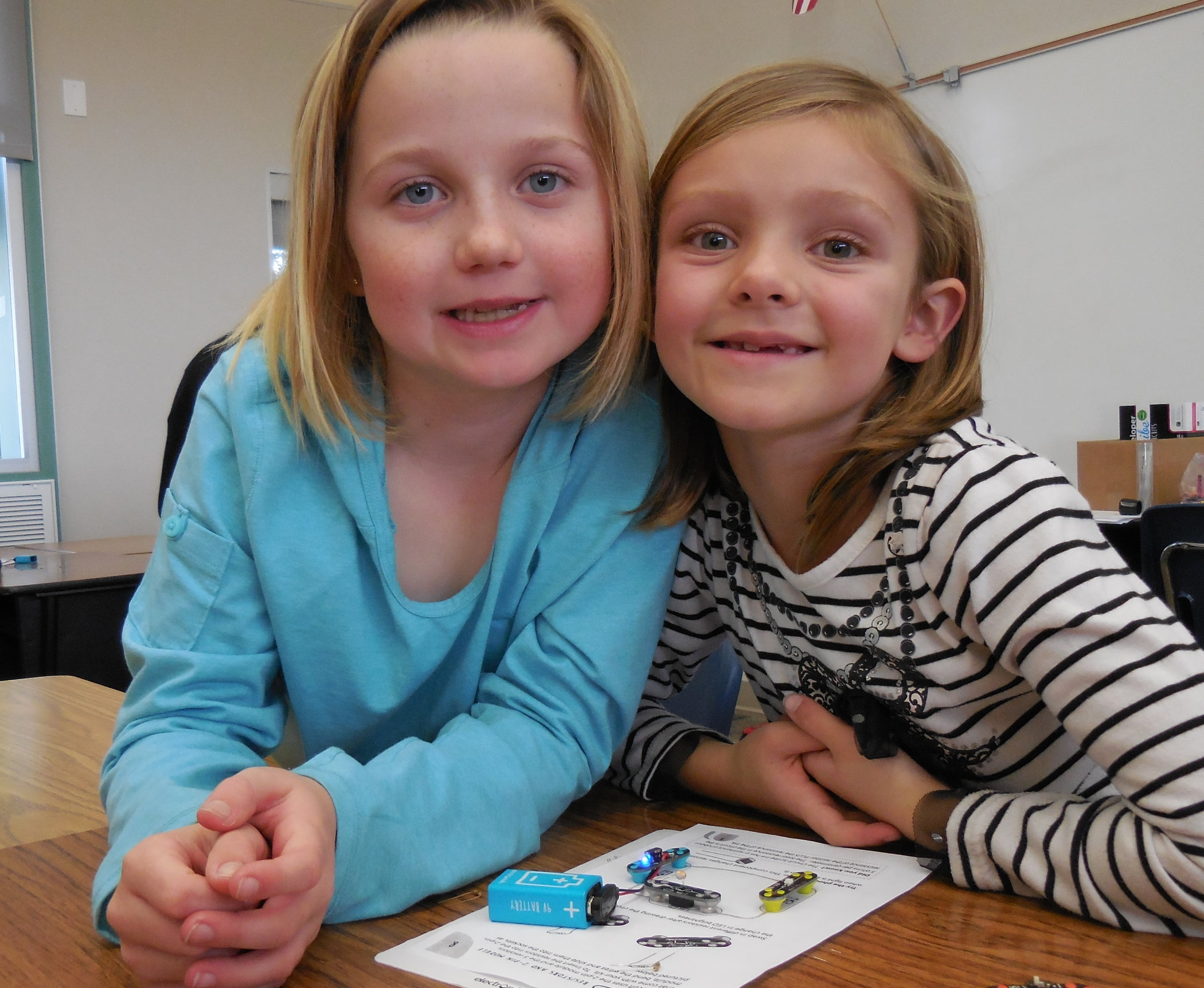 Students exploring in hands-on activities with circuits