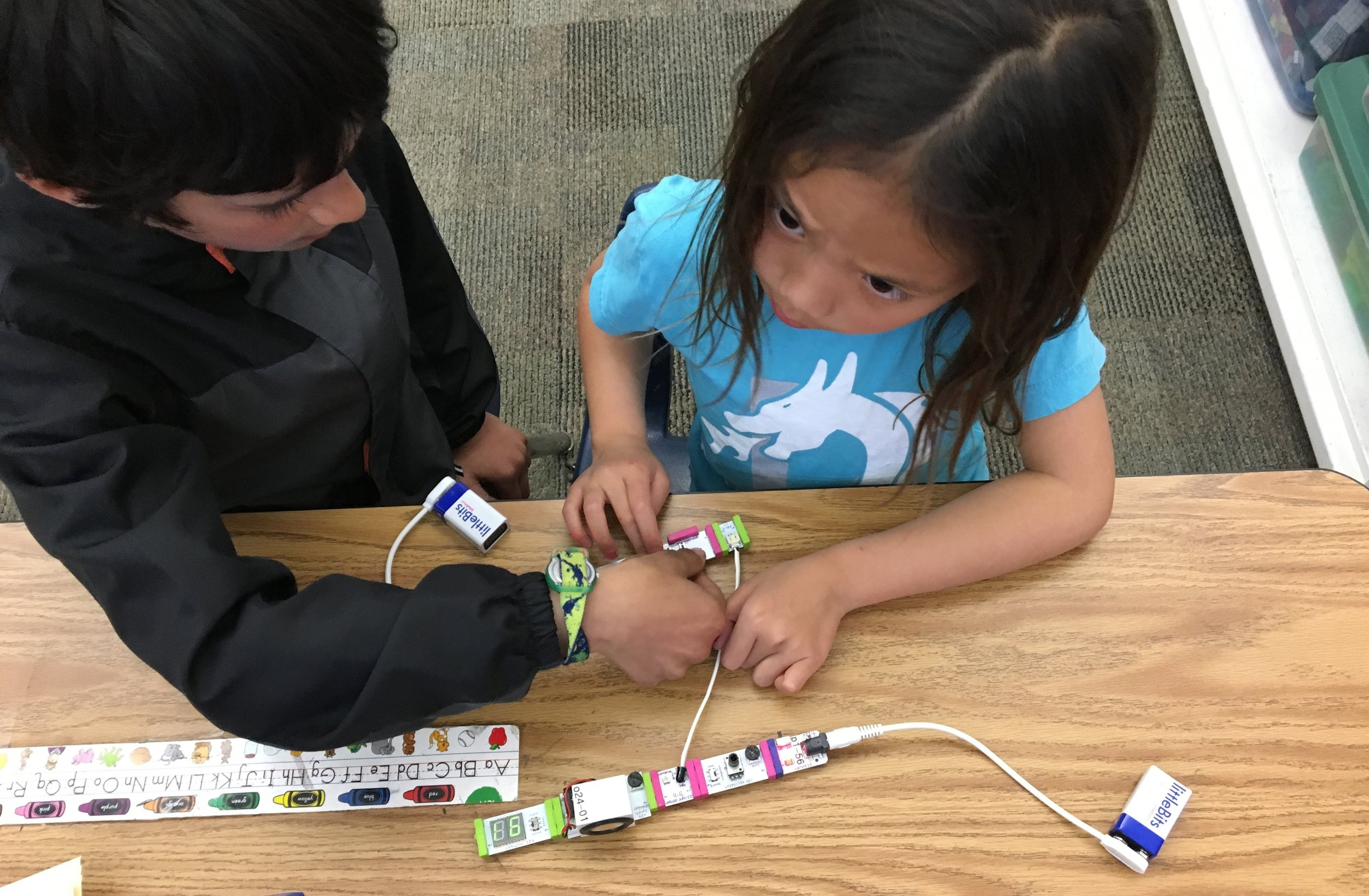 Students learning circuit components with hands-on activities