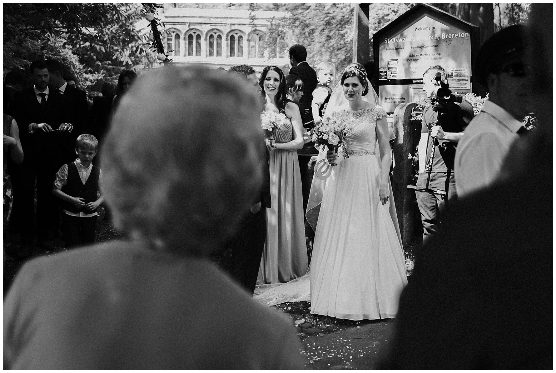 documentary-wedding-photography-bride-and-onlookers-at-st-oswalds-church-brereton-cheshire-louise-jacob