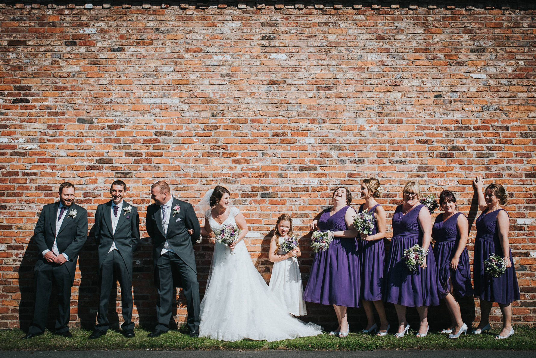 Group photos against a fabulous red brick wall. I have no idea what was said here but obviously something really funny!