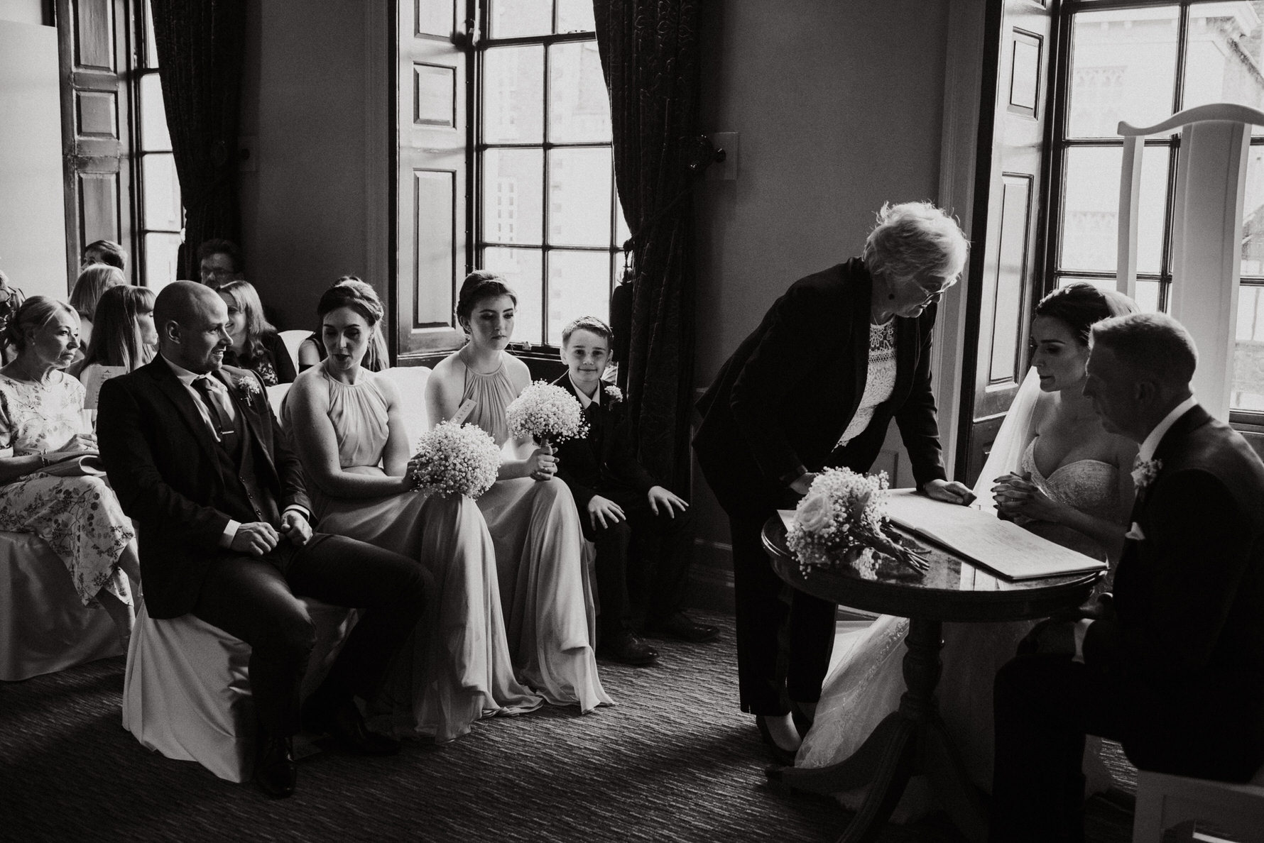 Candid Cheshire Documentary Wedding Photography at The Oddfellows in Chester by Louise Jacob. Prices start at £1500
