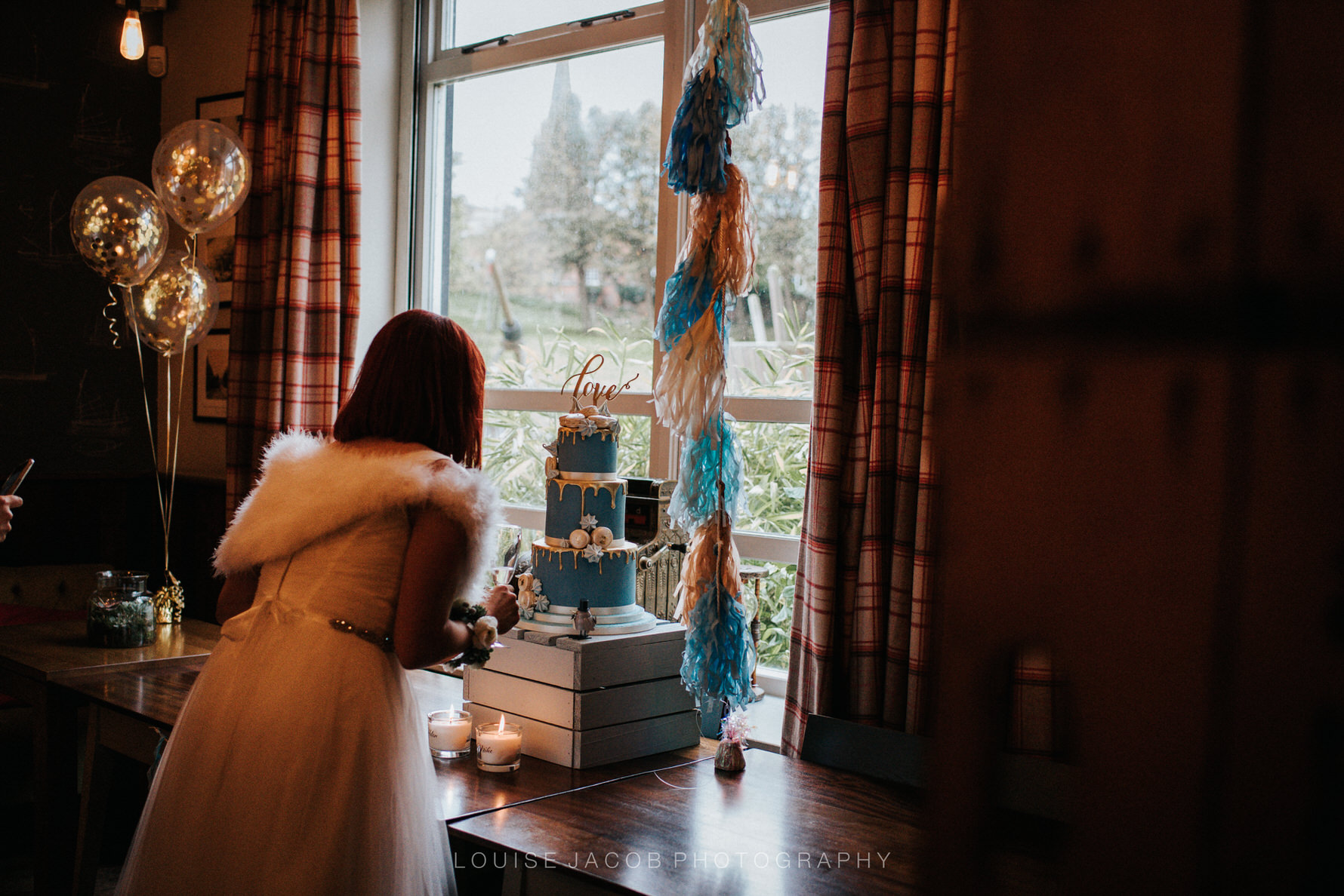 Documentary Wedding Photography bride looking at her wedding cake