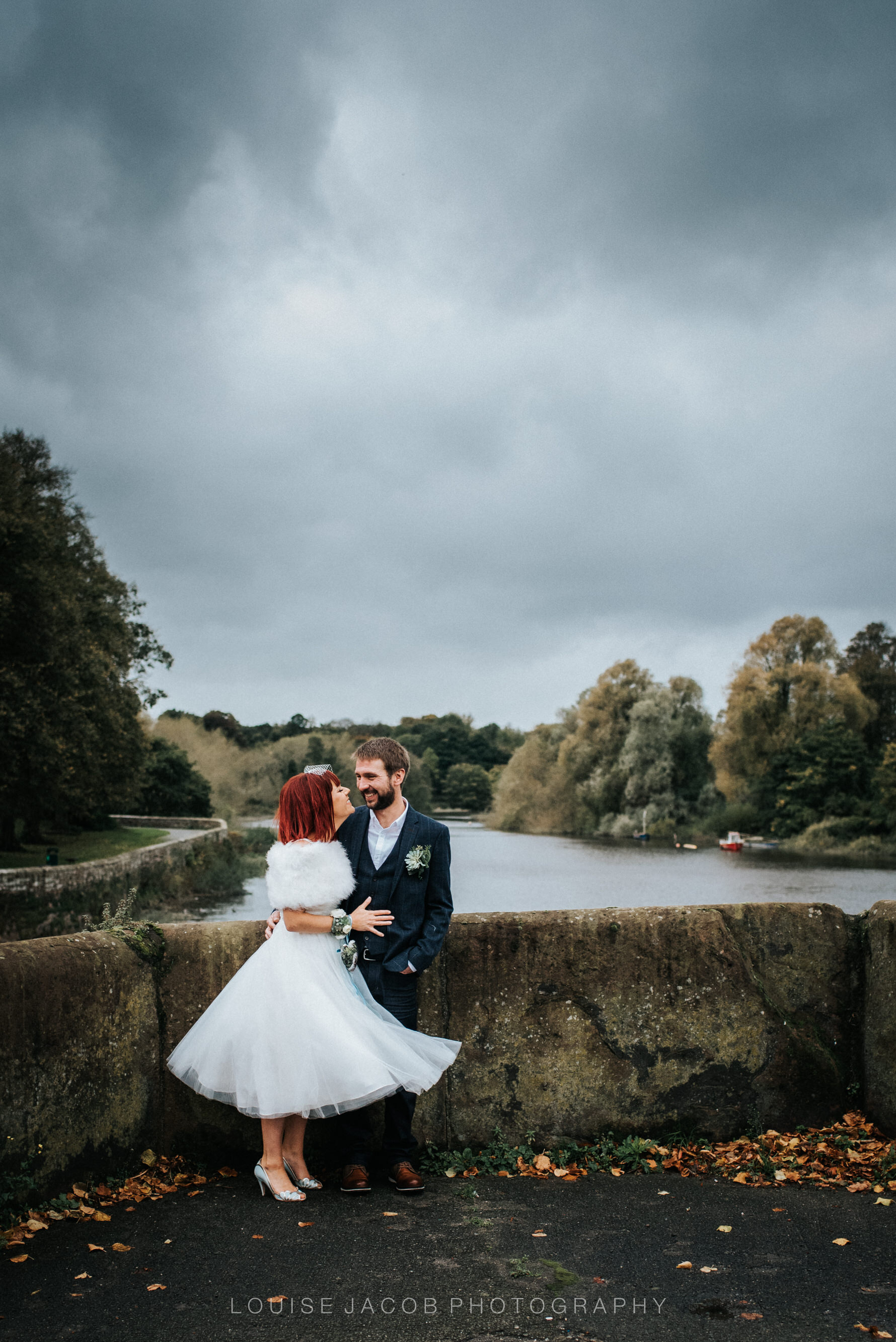 Documentary Wedding Photography - Bride and Groom on a bridge overlooking the River Dee.