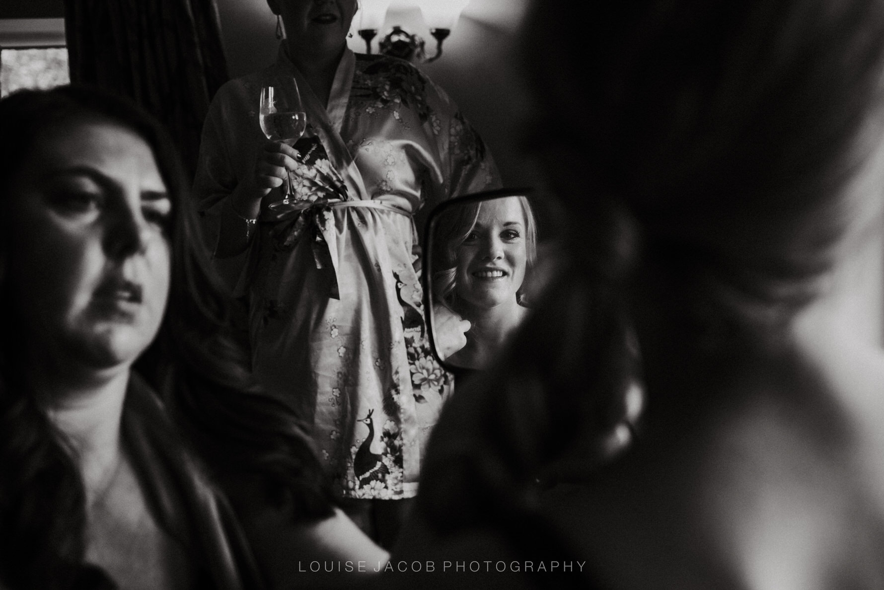 Documentary Wedding Photography bride looking into a mirror