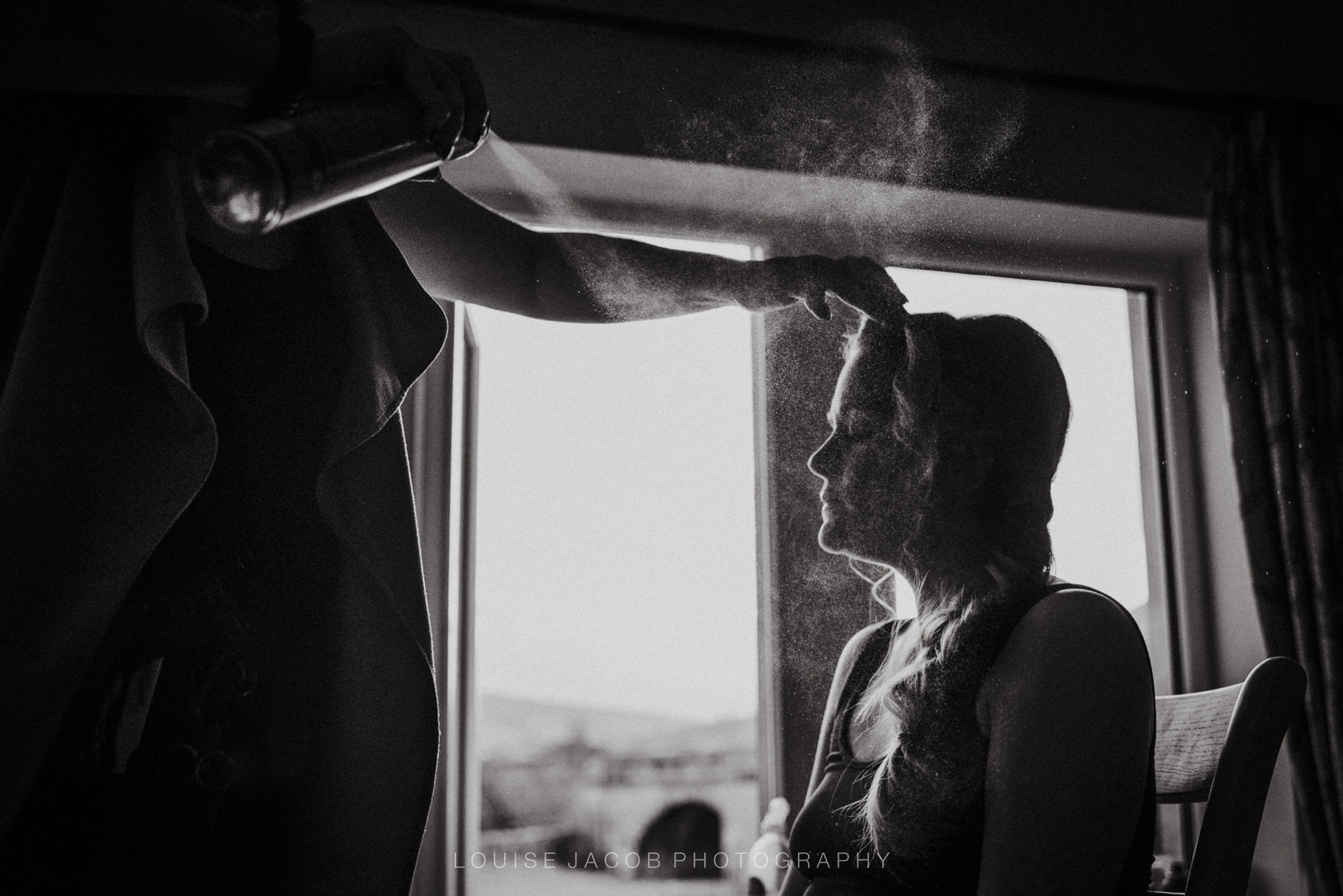 Documentary Wedding Photography - bride getting final touches to her hair