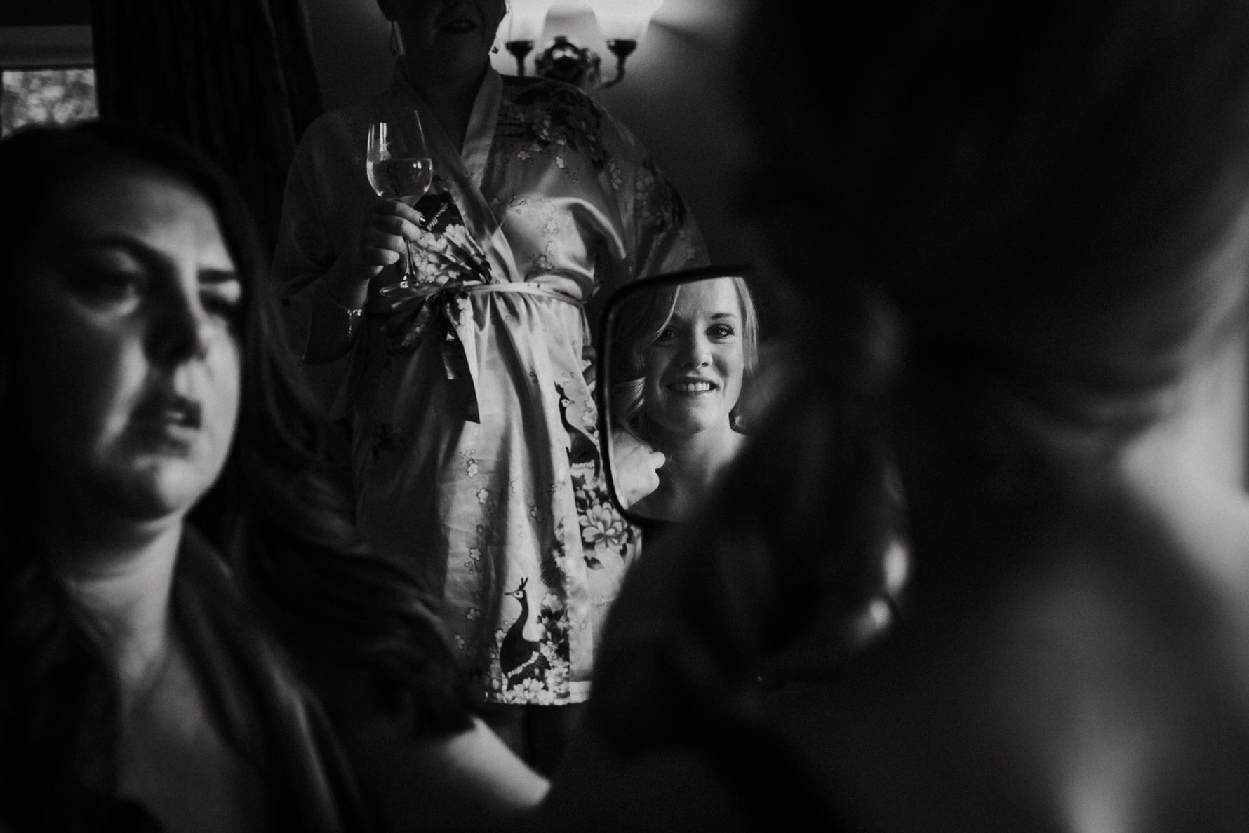 Candid unposed wedding photojournalism by Louise Jacob - An image of a brides reflection in the mirror