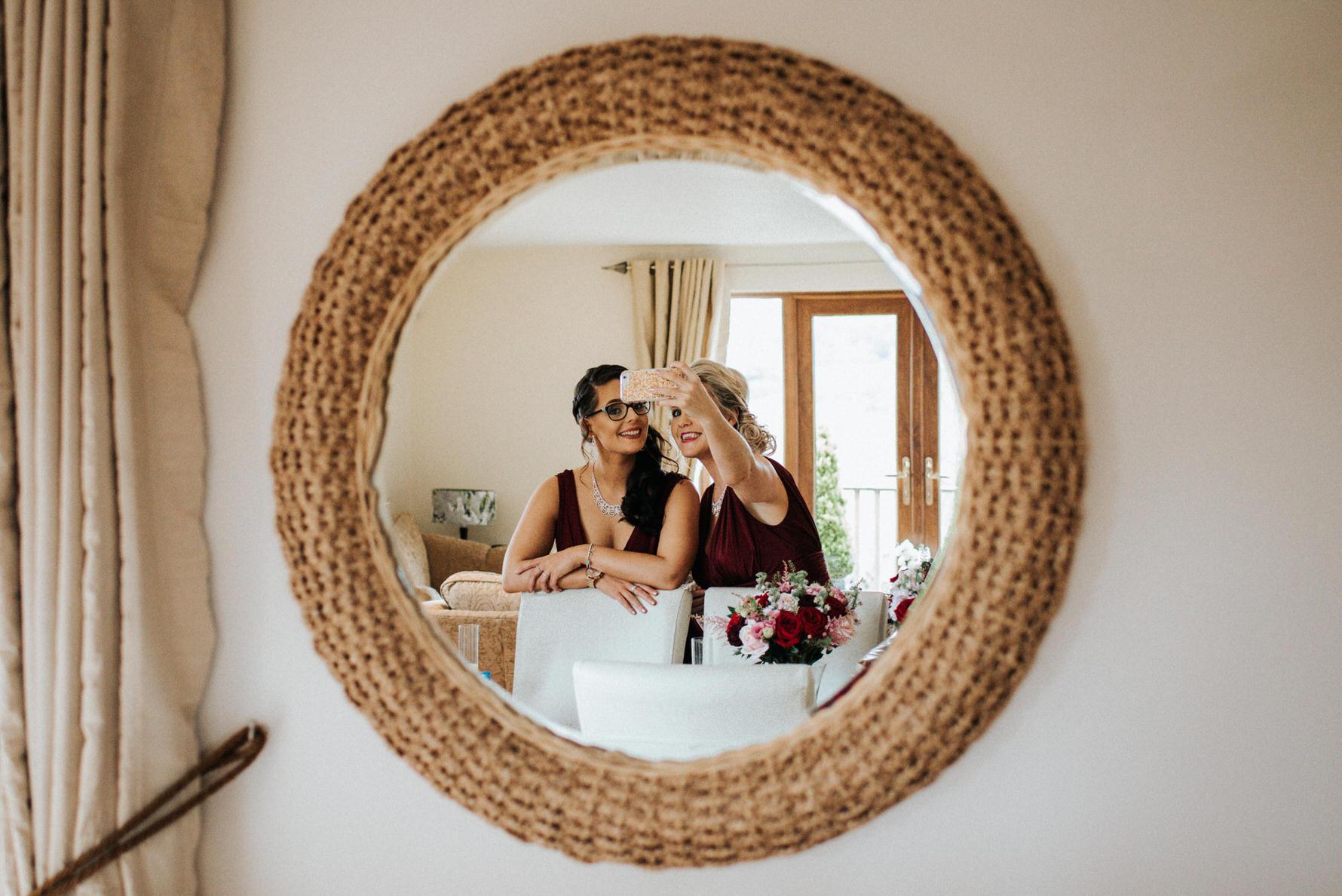 Cheshire Wedding Photojournalism - bridesmaids selfie reflection in the mirror