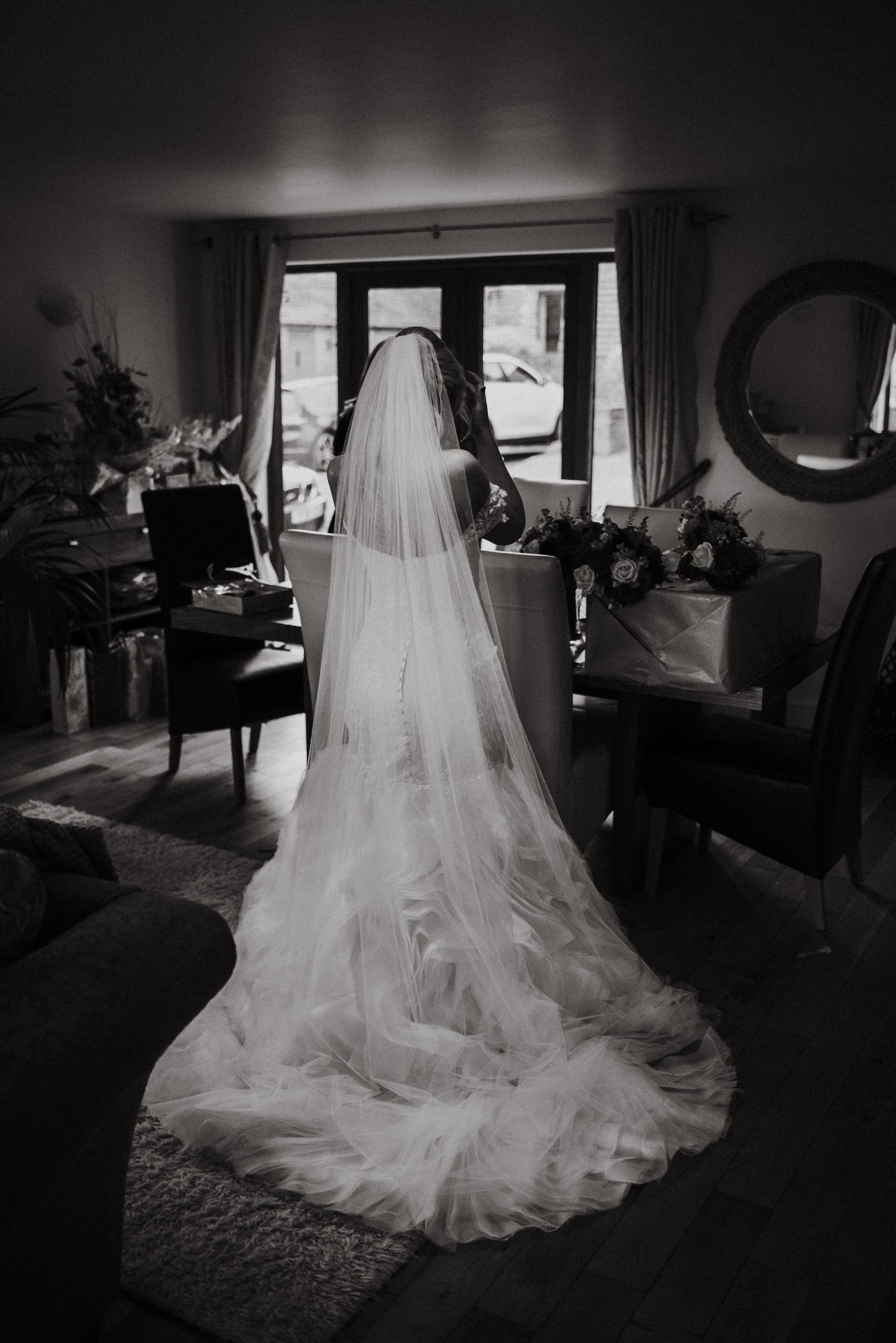 Cheshire Wedding Photojournalism -back of brides wedding gown