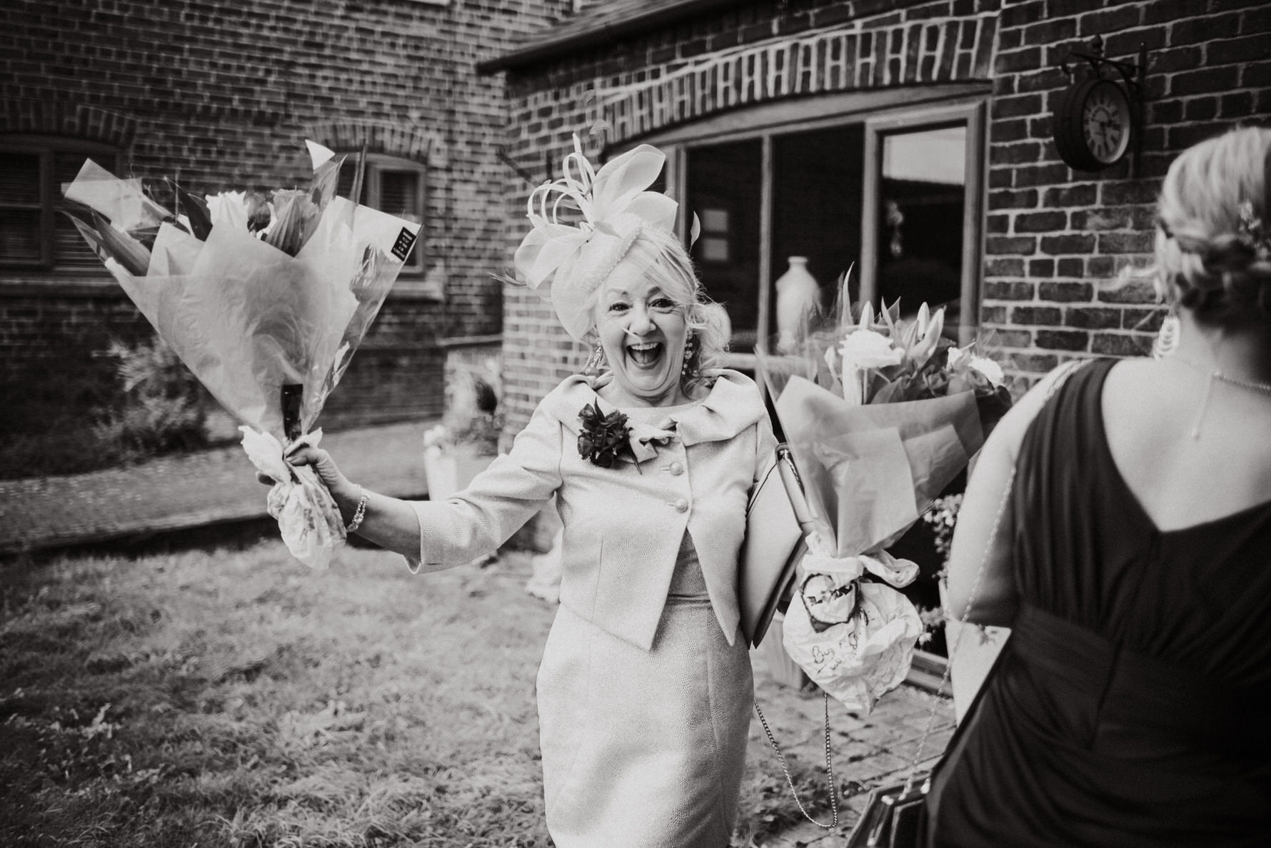 Cheshire Wedding Photographer - Mother of the bride waves at the camera