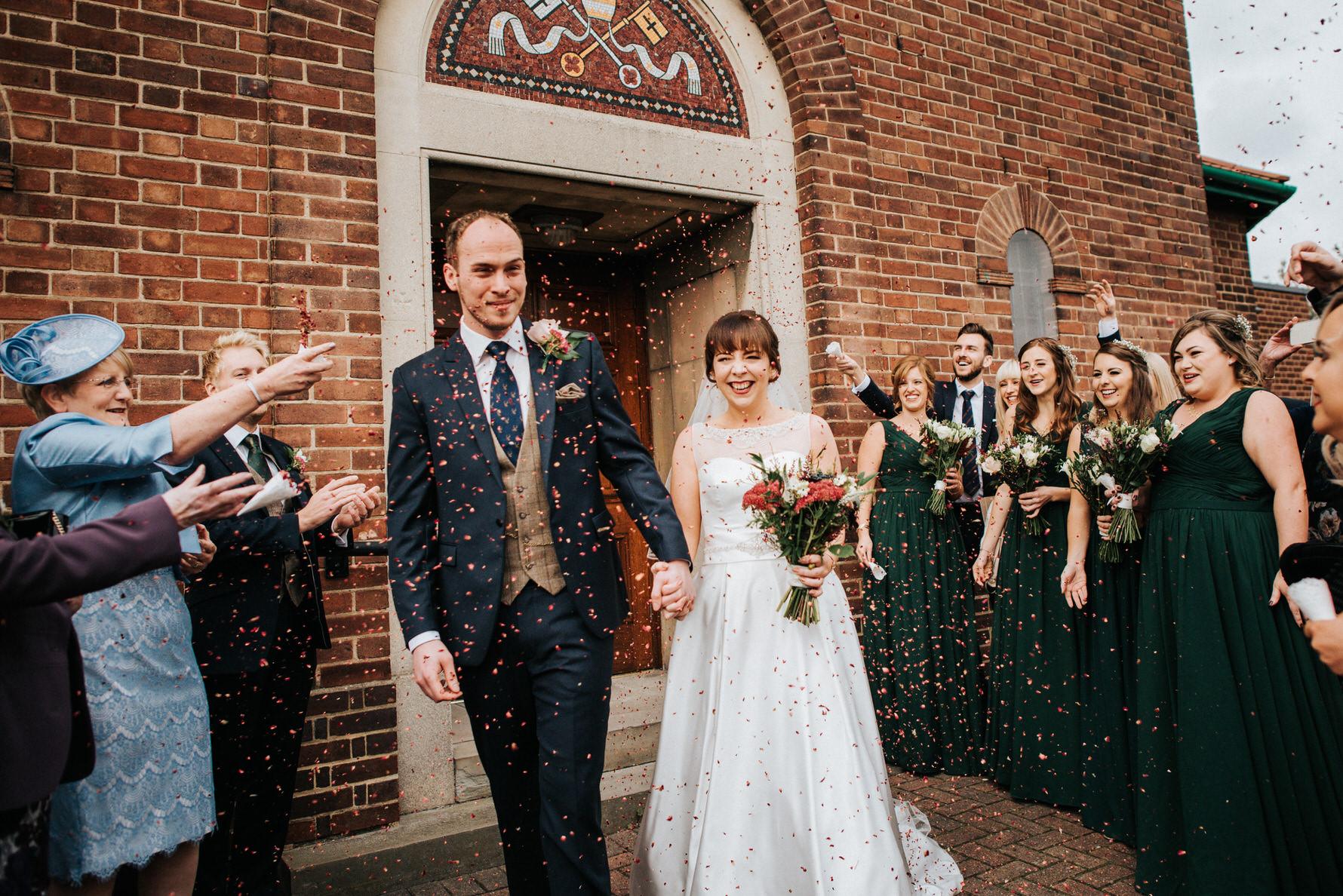 Cheshire Documentary Wedding Photography - Bride and Groom Confetti shot