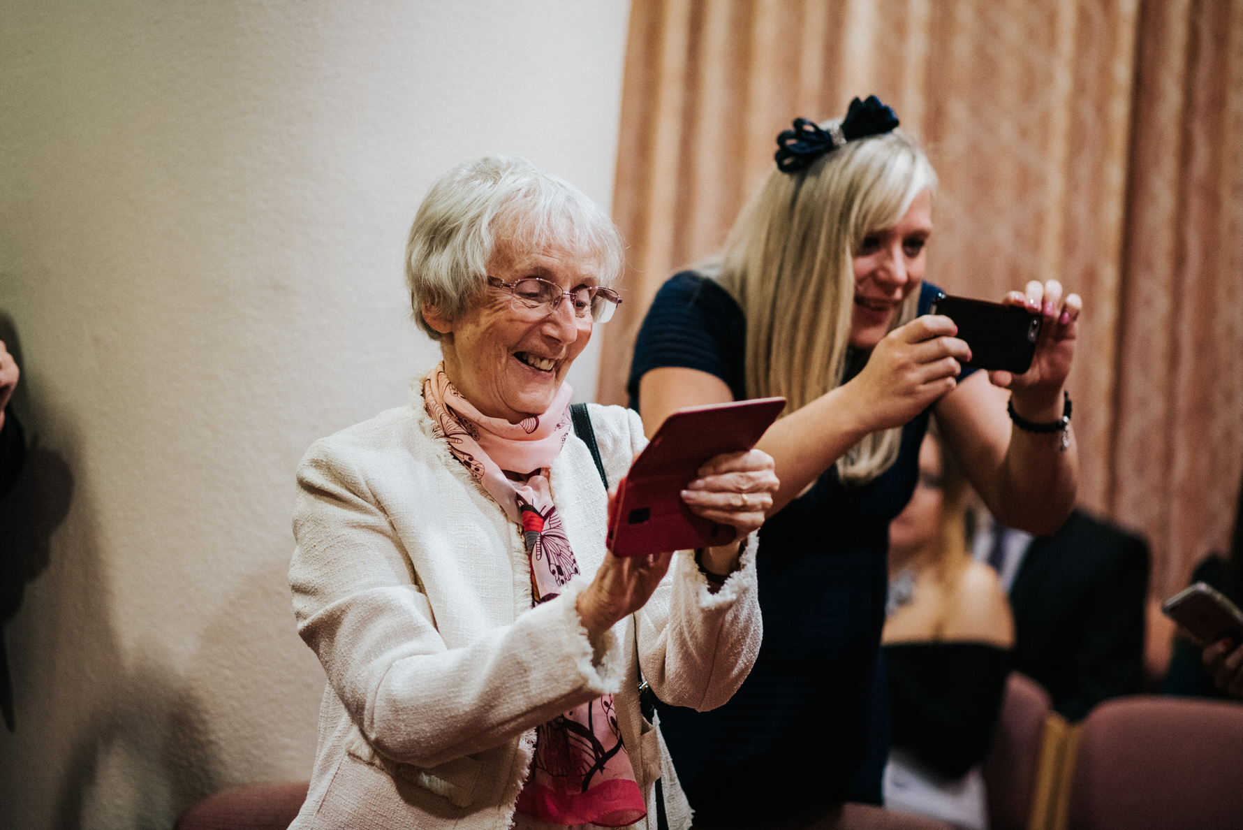 Cheshire Wedding Photojournalism - A guest taking a photograph