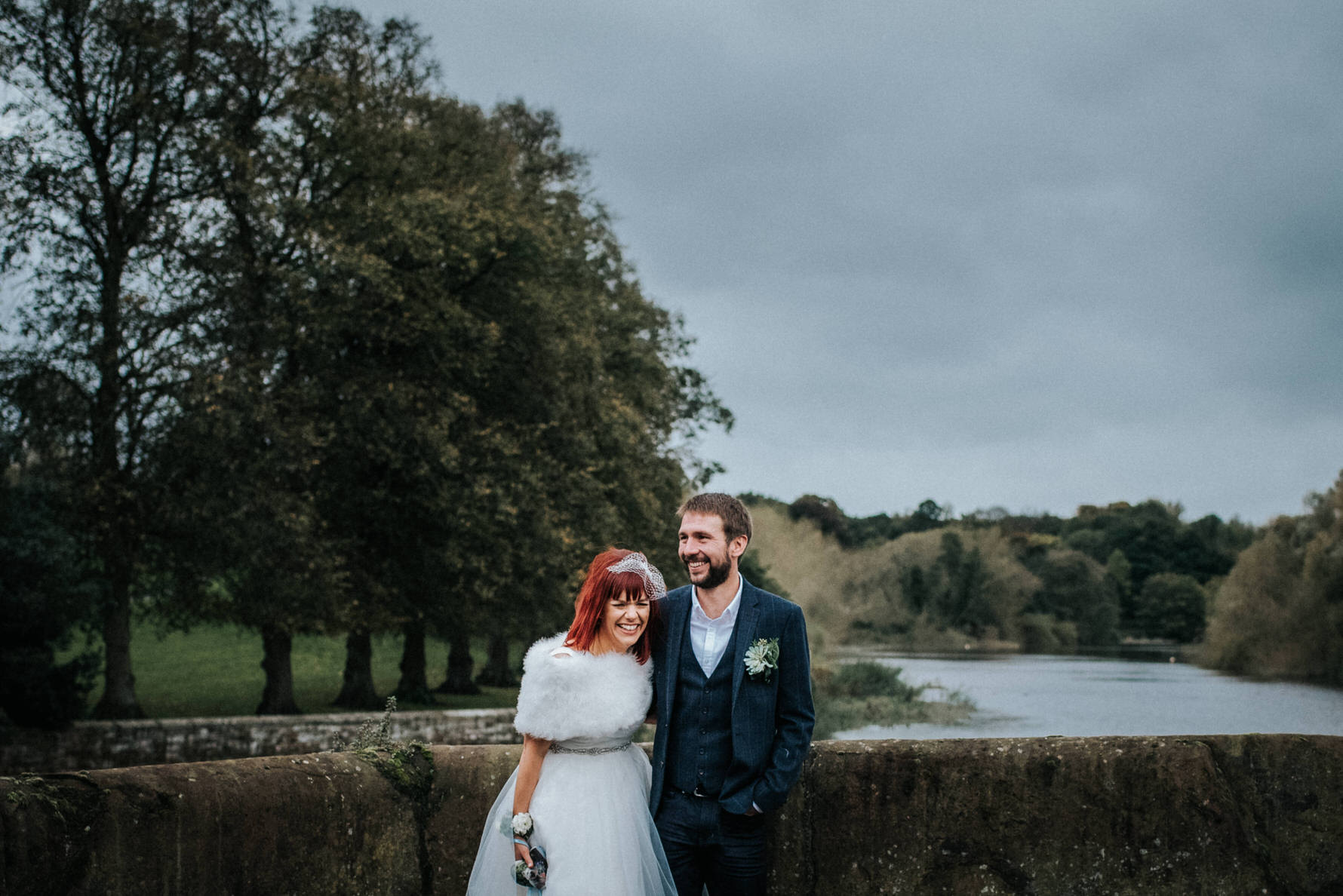 Cheshire Wedding photojournalism - A happy bride and groom on a bridge