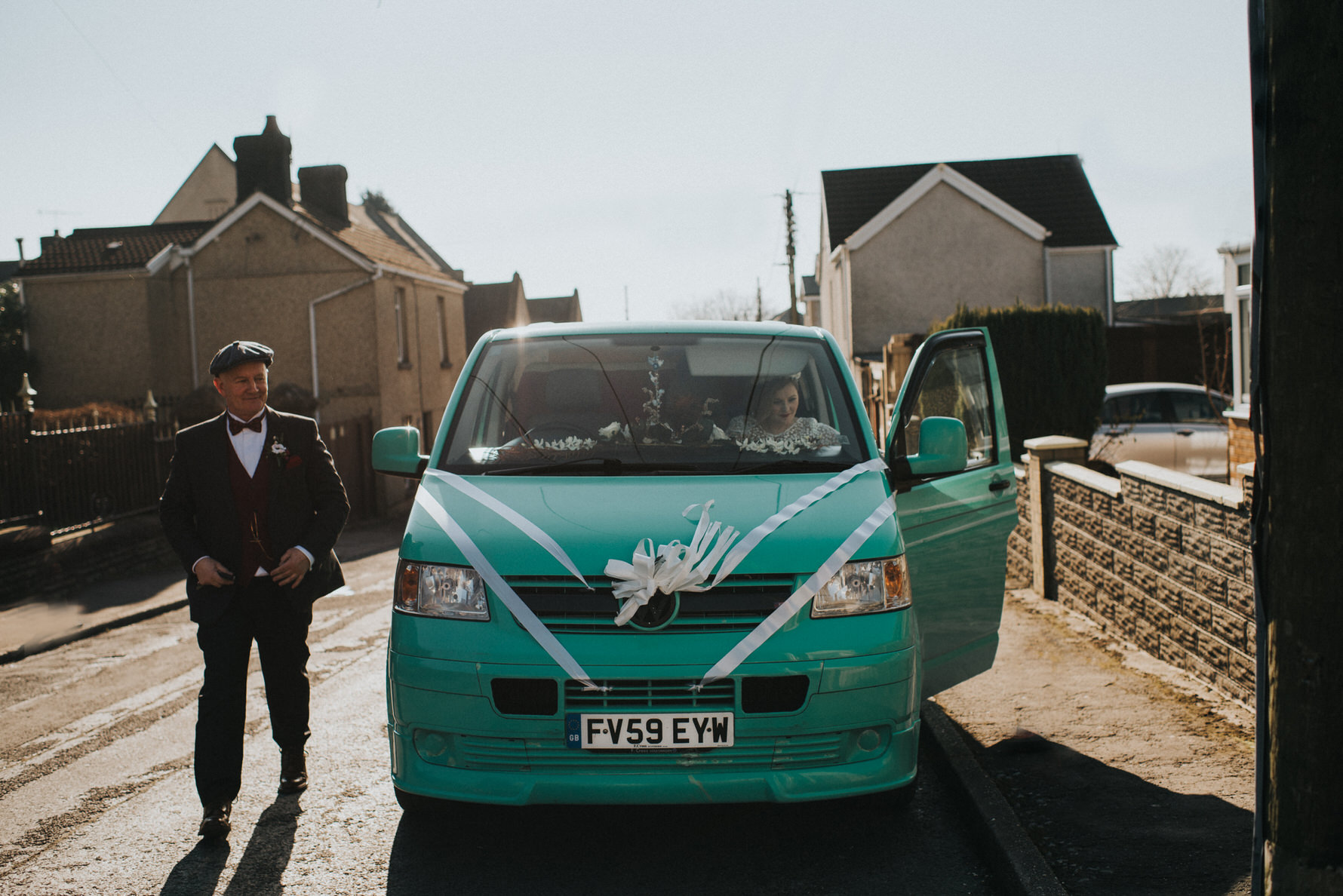 Wedding Photojournalism - bride and father arriving by VW camper van