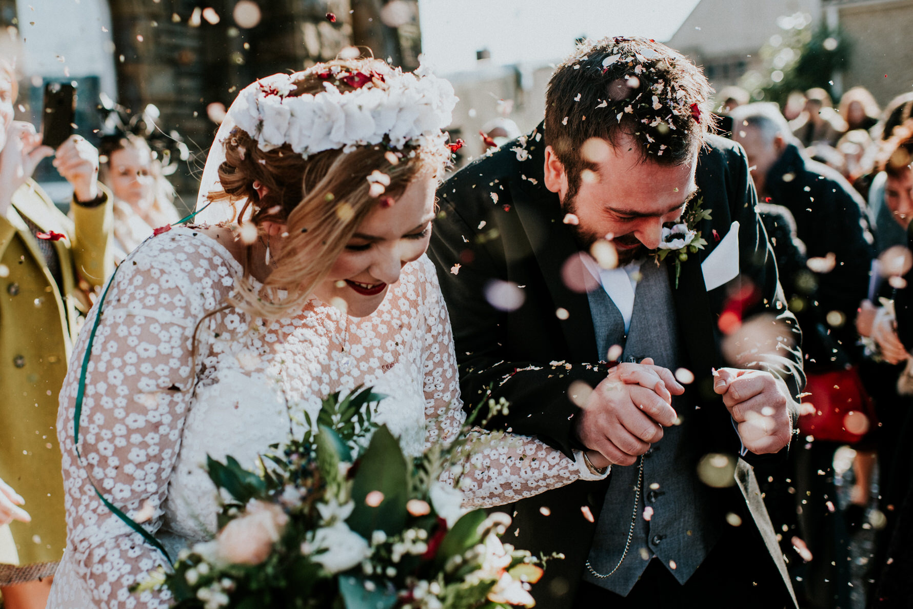 Wedding Photojournalism - bride and groom walk through confetti