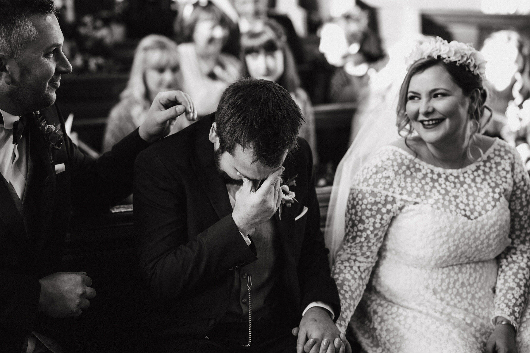 Wedding Photojournalism - A groom in tears at the wedding ceremony