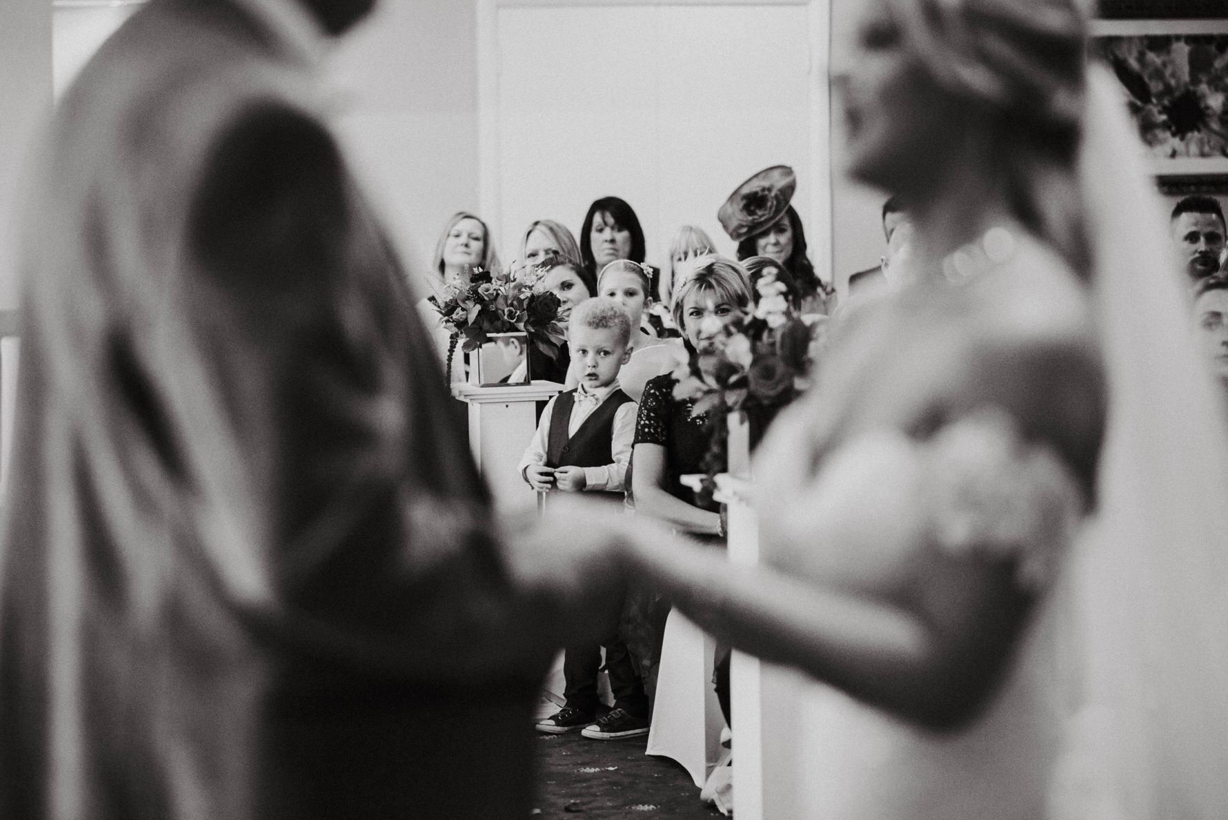Documentary-wedding-photography-page-boy-watching-wedding-ceremony.jpg