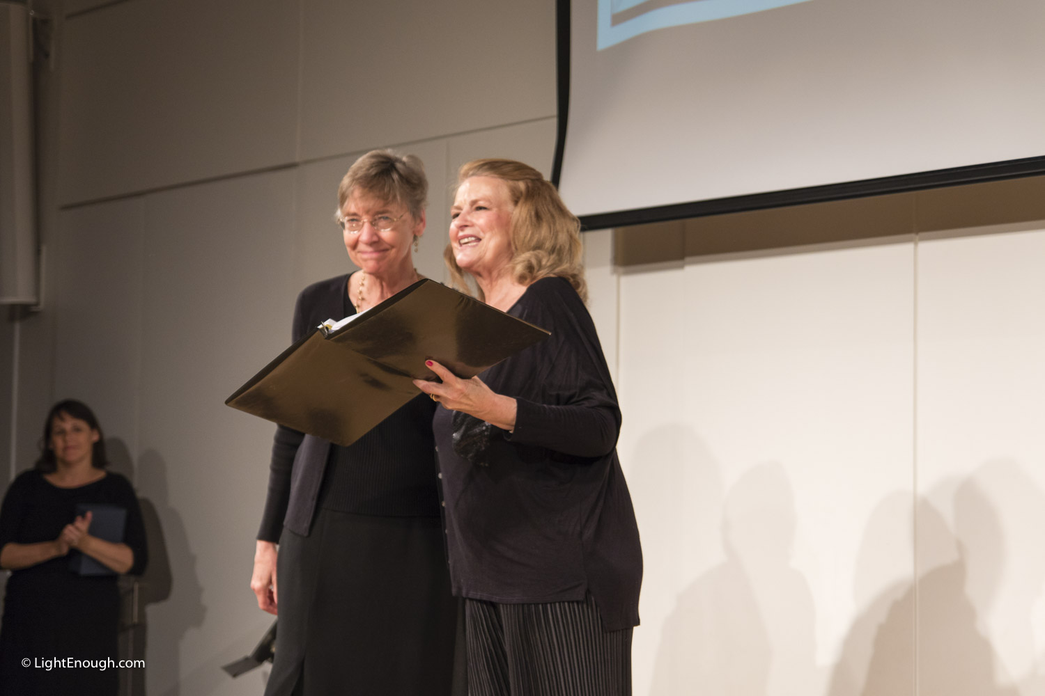 Diane Dorius, Chair Cabaret Planning Committee presents Award to long-serving Music Director Barbara Schelstrate at the UUCA Chalice Theatre Cabaret 20 year review (2016) Photo by John St Hilaire at www.lightenough.com