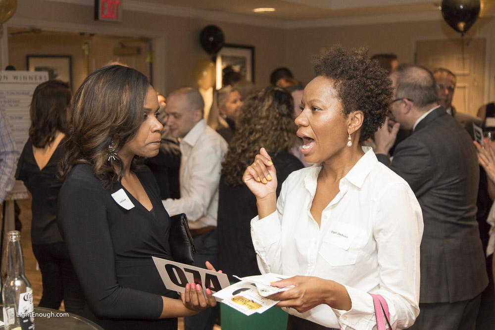 B2I guests Janetha Brwer and Angel Jackson  chat at the Bridges to Independence Black & Gold Gala May 19, 2017. Photos by John St Hilaire of LightEnough.com