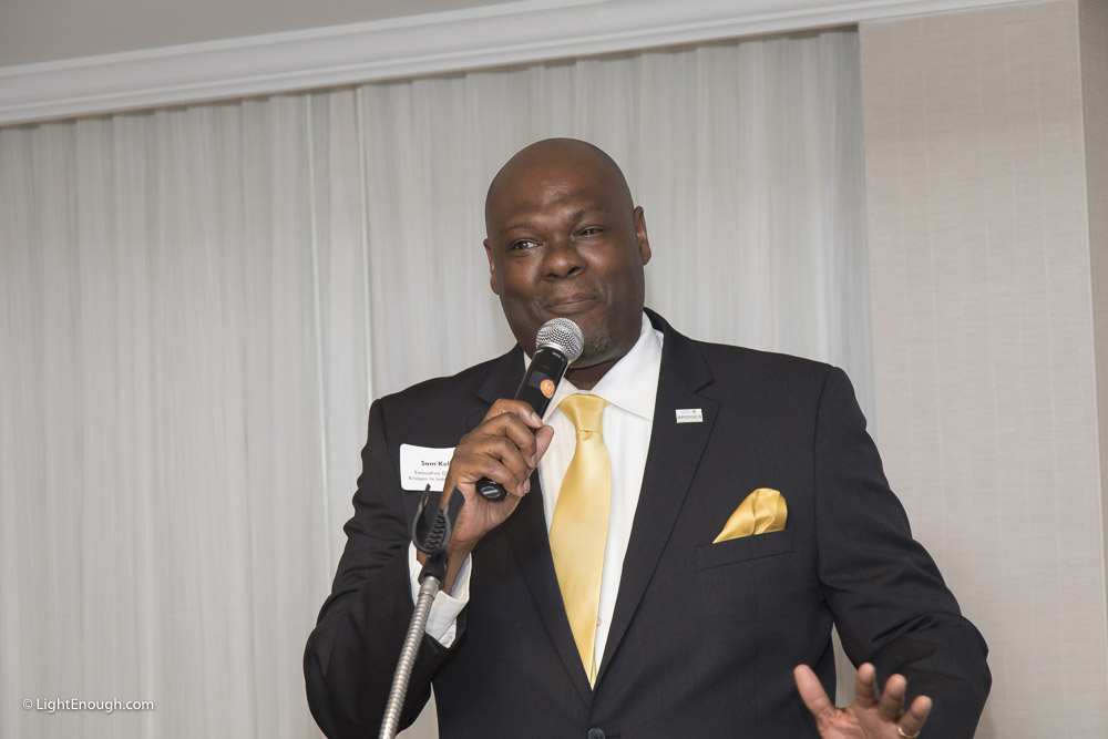 B2I Executive Director Sam Kelly explains the mission of B2I and appeals for support at the Bridges to Independence Black & Gold Gala May 19, 2017. Photos by John St Hilaire of LightEnough.com