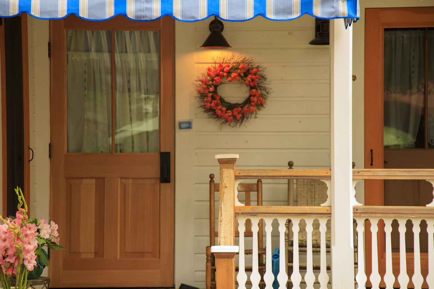 One of many way too cute for words houses. Chautauqua homes feature porches, lots of them, gingerbread, and flowers!