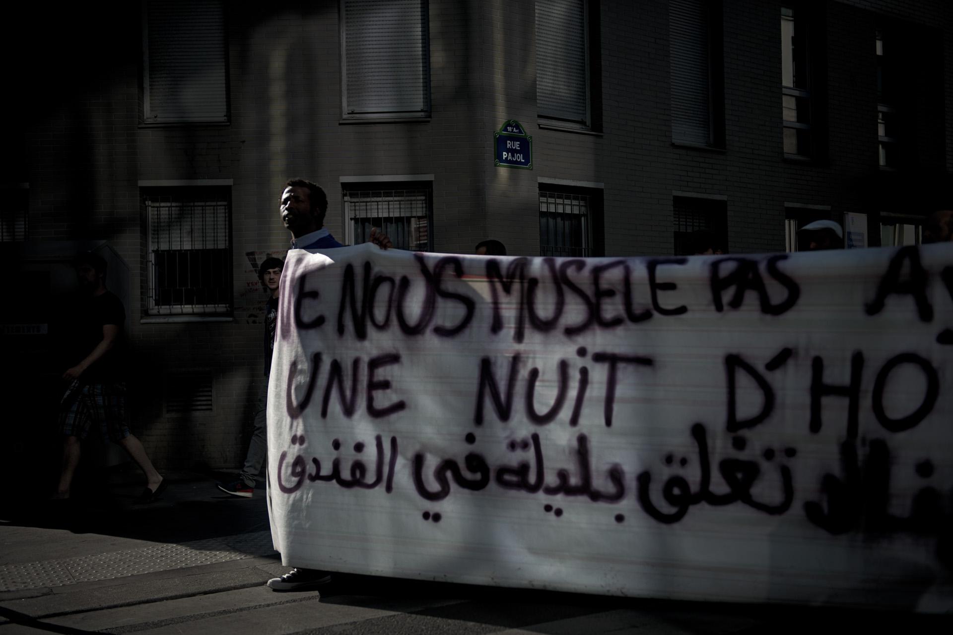 Manifestation de République à Barbes pour réclamer des hébergements et des papiers pour tous. Paris, le 9 juillet 2015.