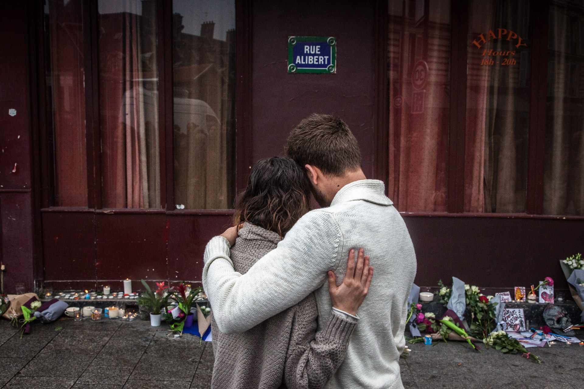 "Paris, Saturday 14th november 2015. A couple in front of ""Le Carillon"", a bar where twelve people were shot dead in a terrorist attack."